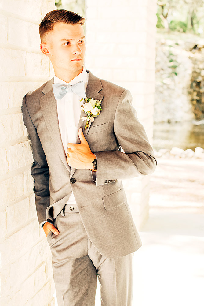 groom in gray suit in san antonio texas