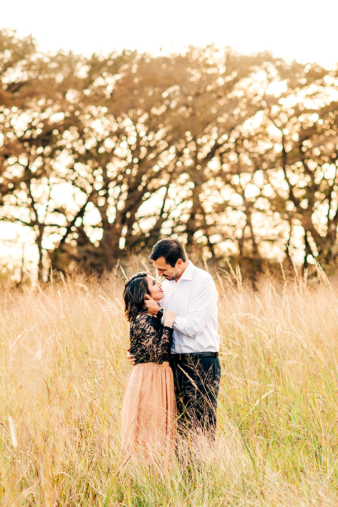 couple hugging in field in san antonio texas