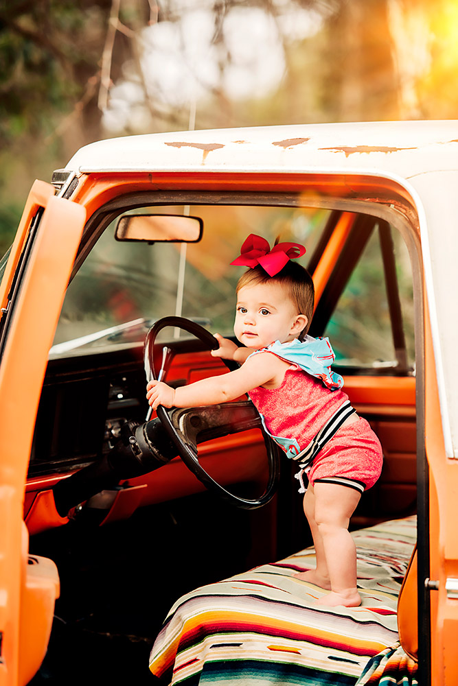 baby standing in car in san antonio texas