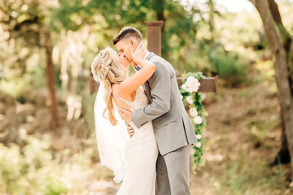 bride and groom kissing in texas hill country