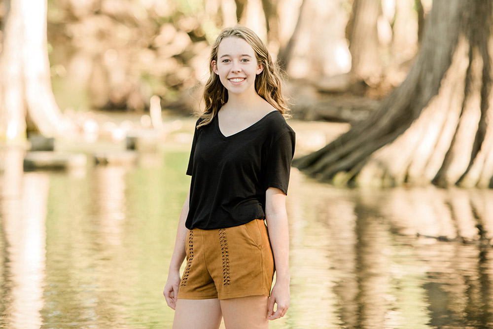 teen girl standing next to pond in san antonio texas