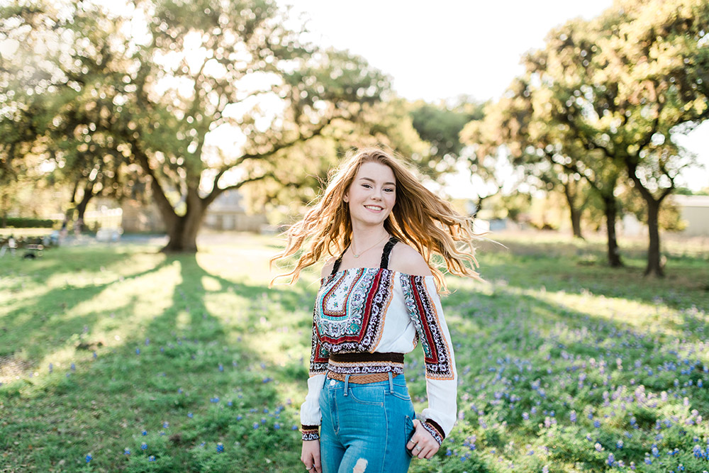 teen girl standing in field in san antonio texas