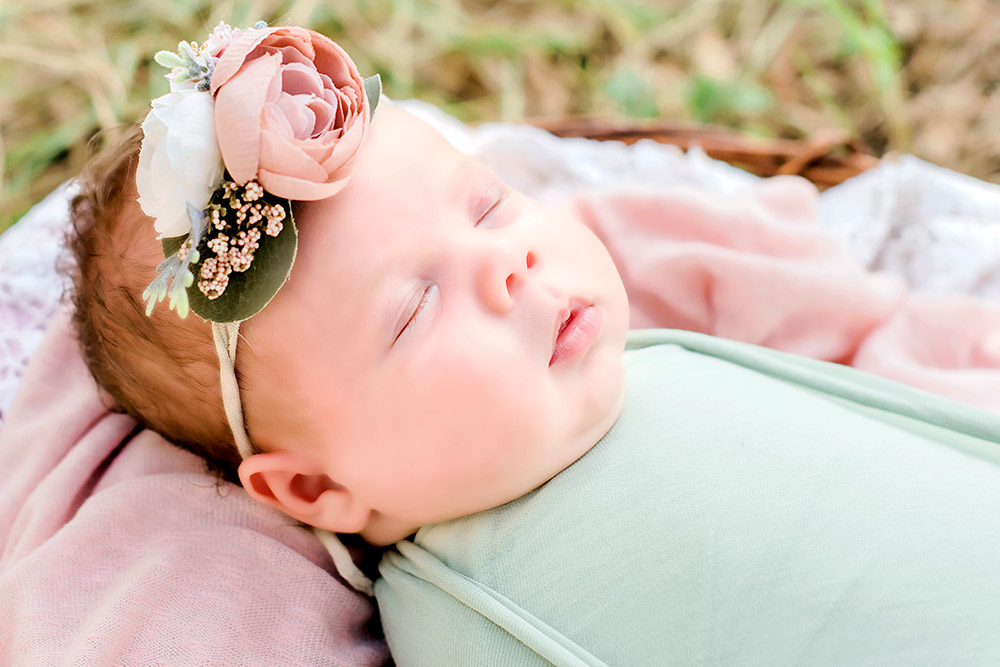 newborn baby with flower headbeand in san antonio texas