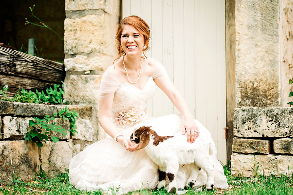 bride petting a goat in san antonio texas