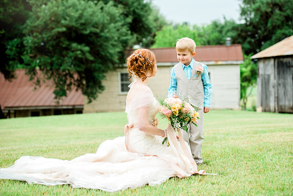 bride smiling at ring bearer in san antonio texas