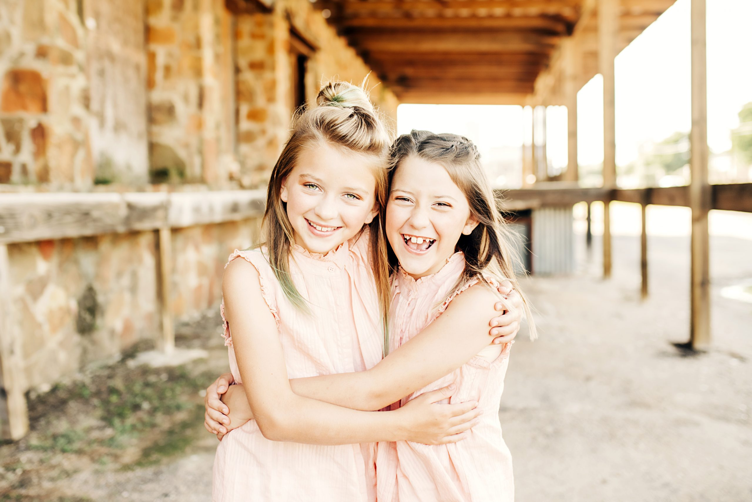 two girls hugging in texas hill country