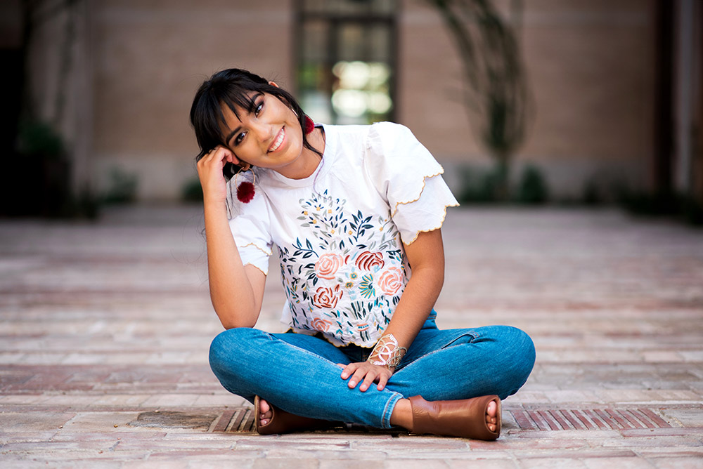 teen girl sitting on ground in san antonio texas