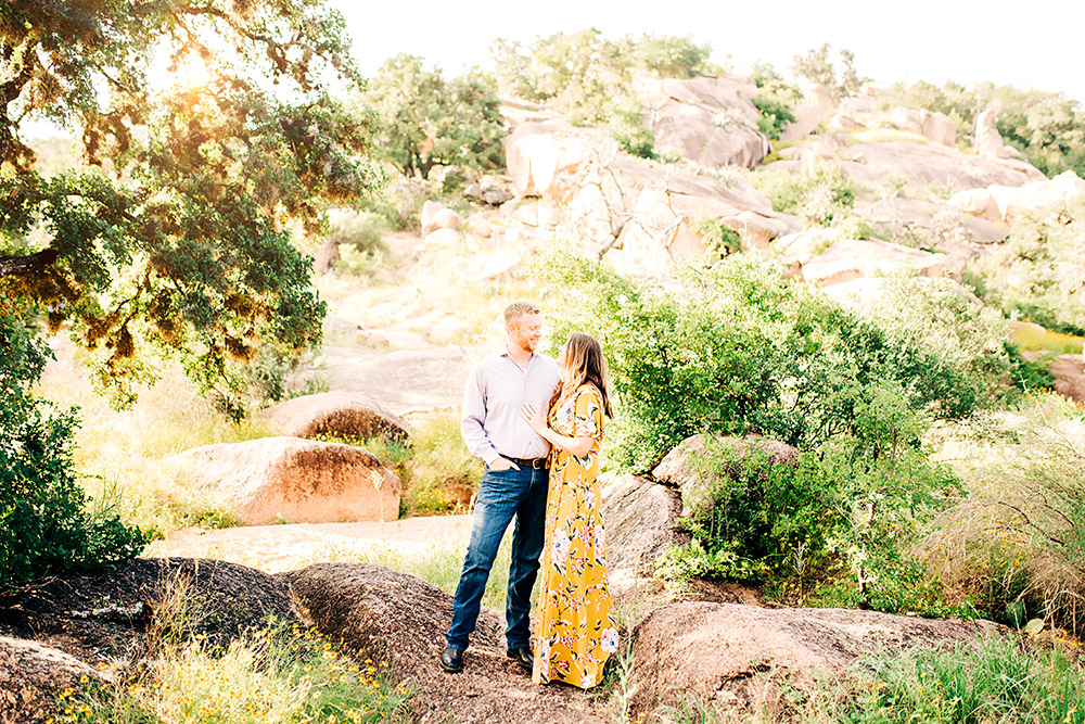 couple smiling at each other in texas hill country