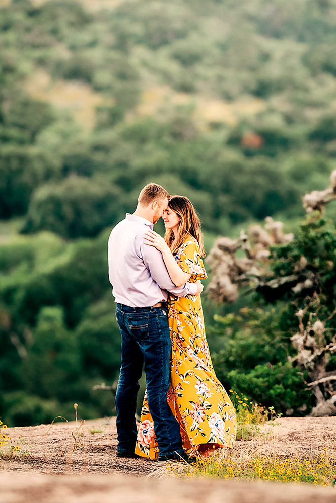 couple hugging in texas hill country
