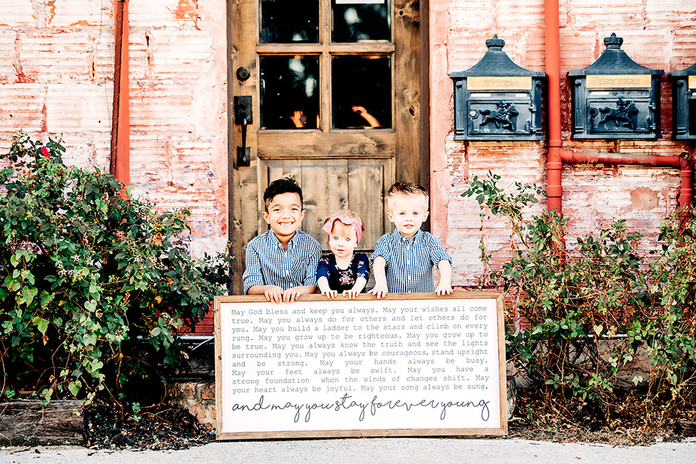 three kids with sign in san antonio texas