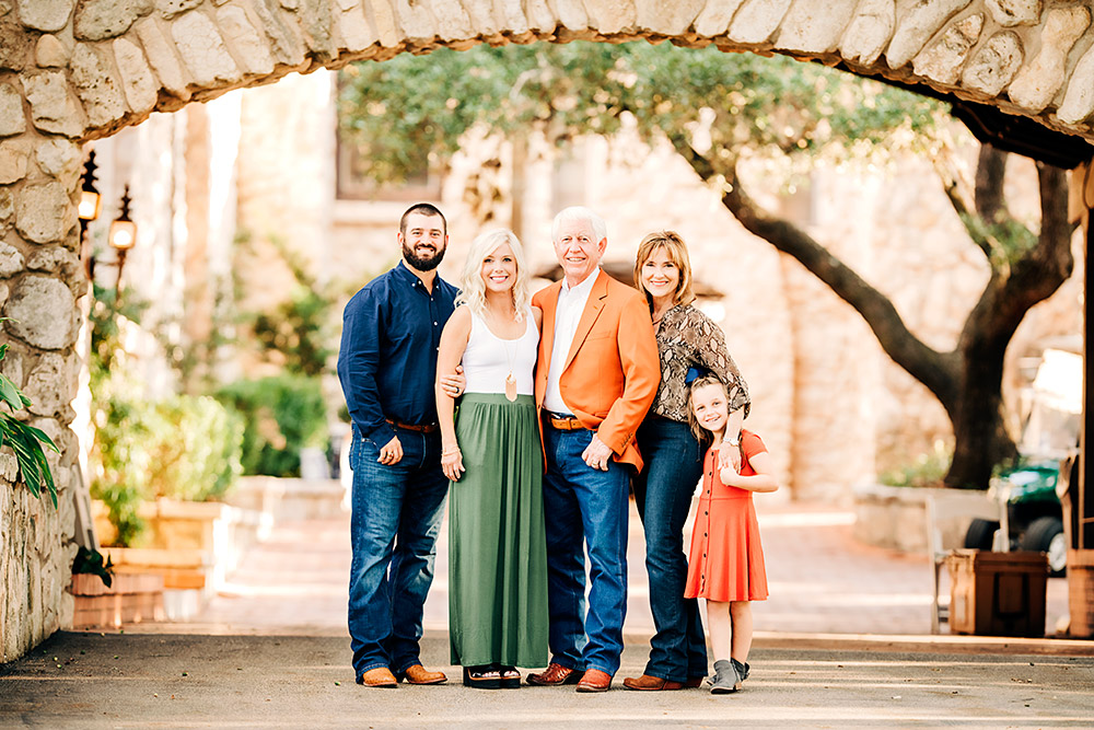 family standing under arch in san antonio texas