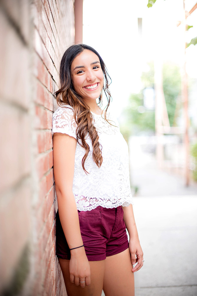 teen girl leaning against wall in san antonio texas
