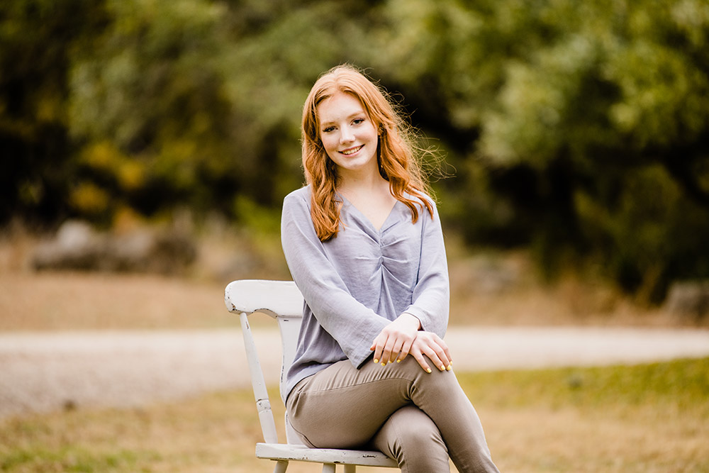 teen girl sitting on chair in san antonio texas