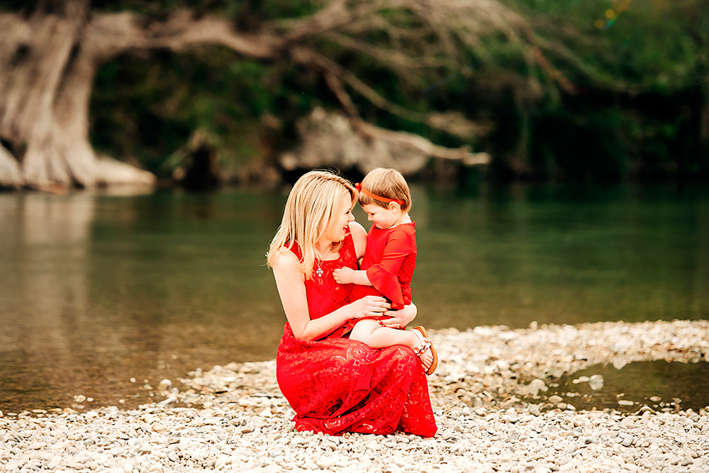 mom and daughter by pond in san antonio texas