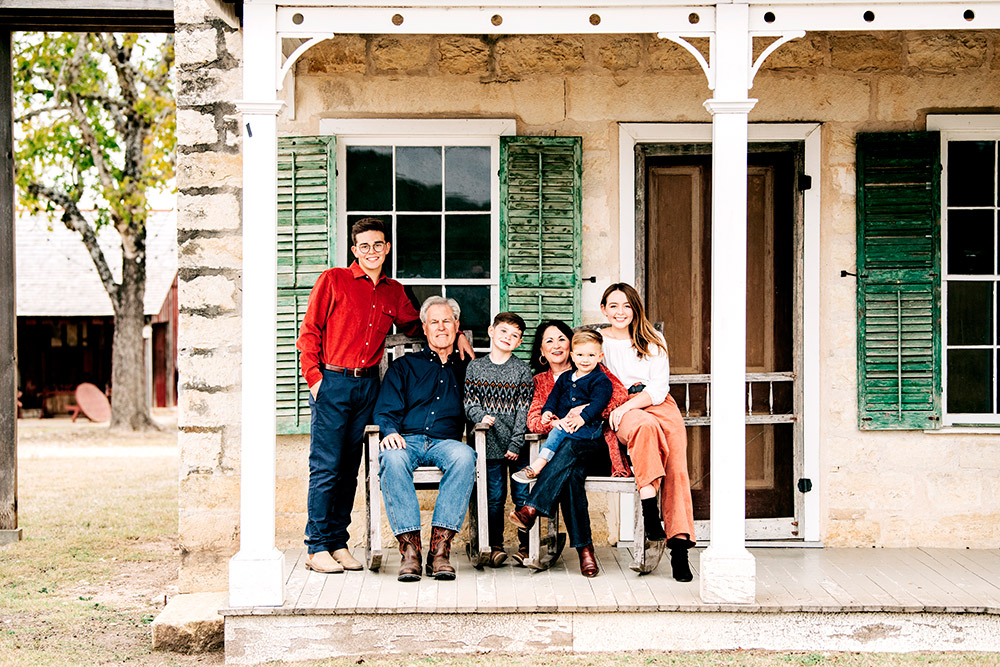 family sitting on porch in san antonio texas