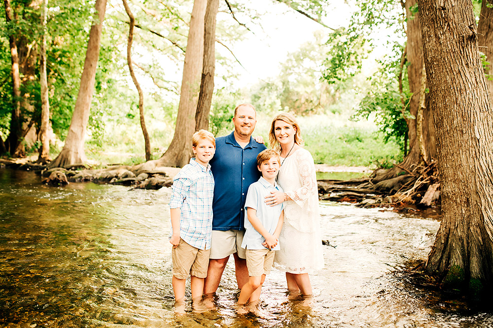 family standing in pond in san antonio texas
