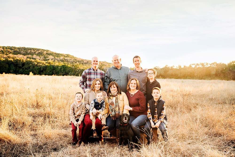 family standing in field in texas hill country