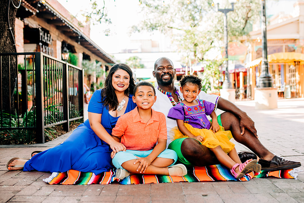 family sitting on ground in san antonio texas