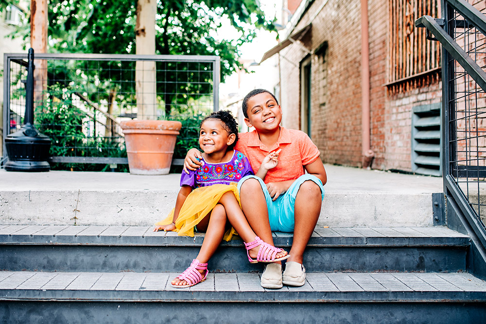 two kids smiling at each other in san antonio texas