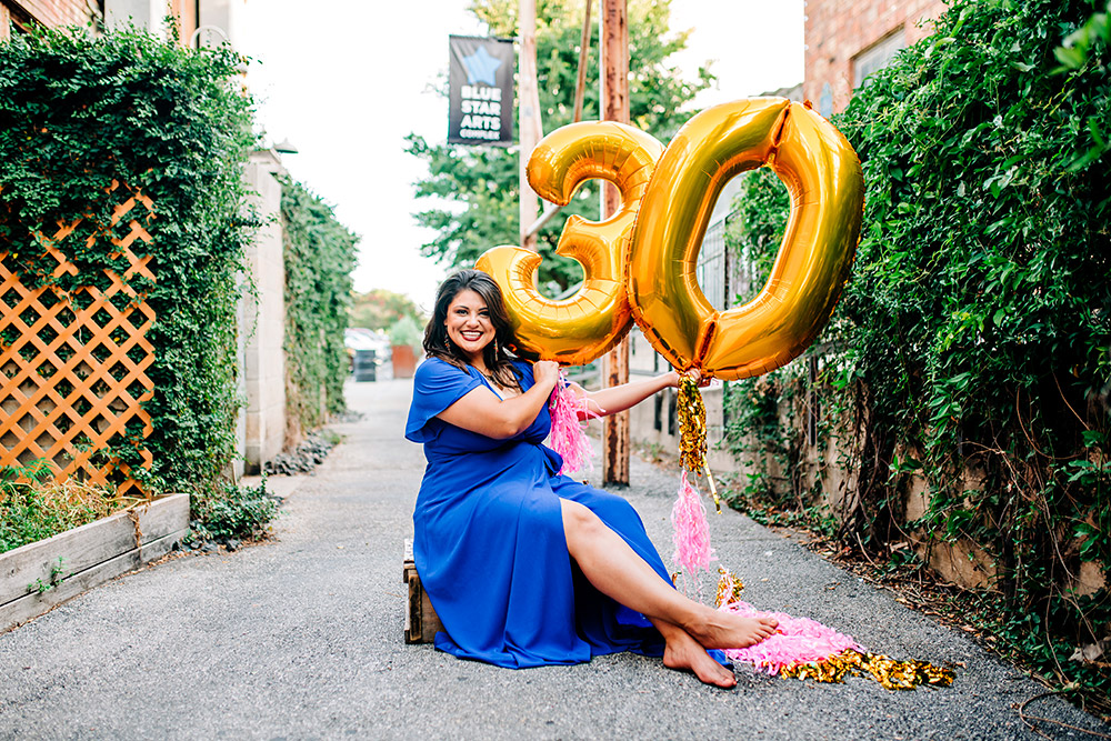woman holding balloons in san antonio texas