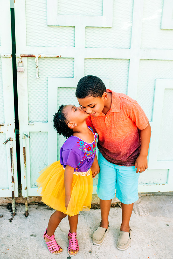 little girl kissing little boy on cheek in san antonio texas