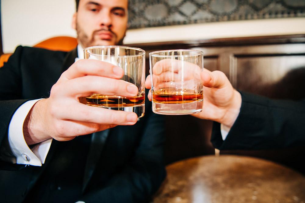 groomsmen sharing a drink in san antonio texas