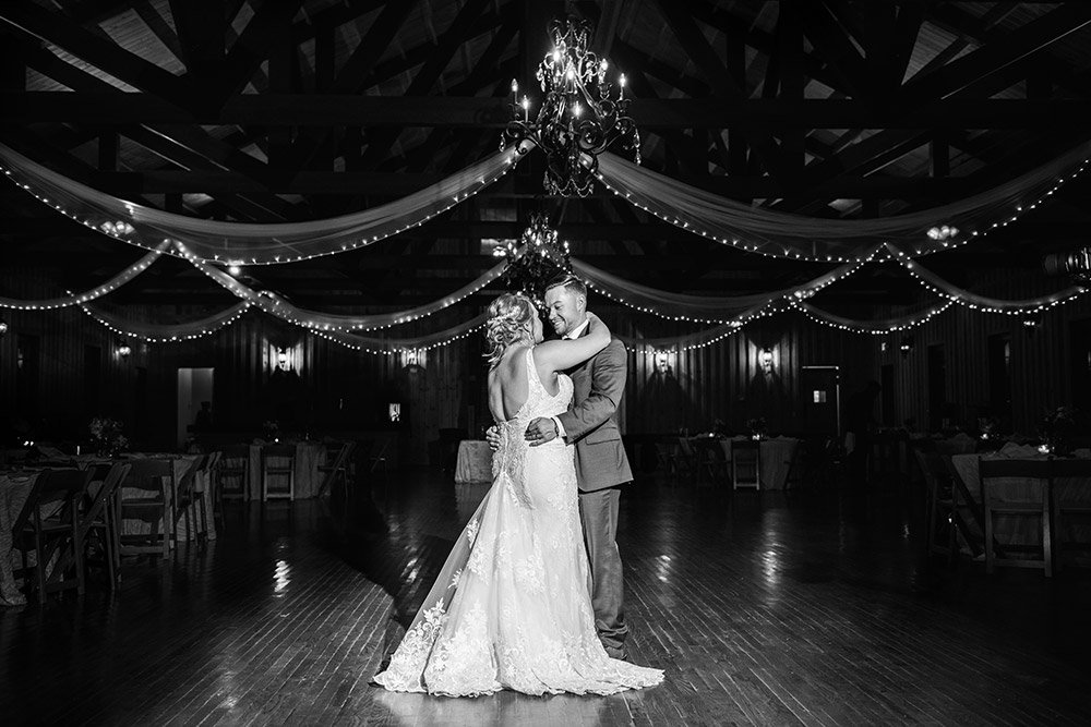 bride and groom dancing in texas hill country