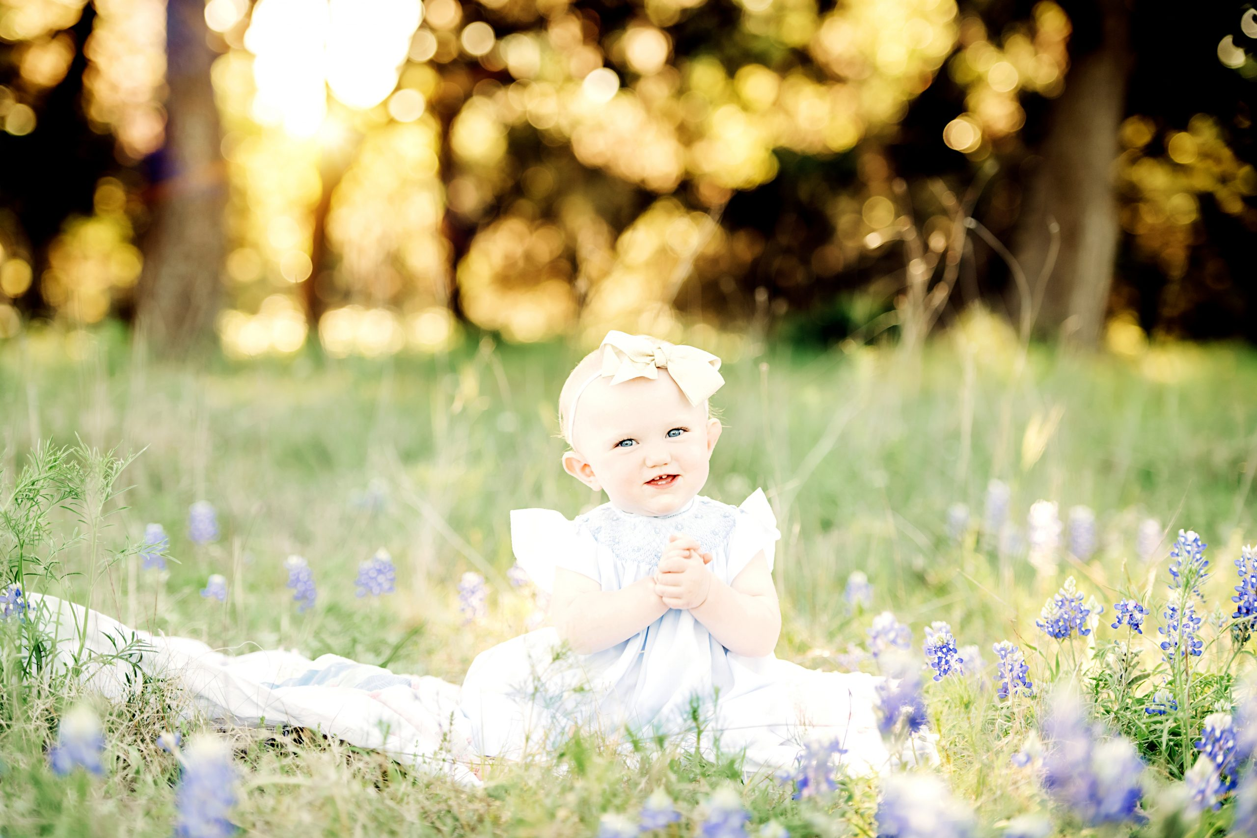 baby in bluebonnet field in hilly country texas