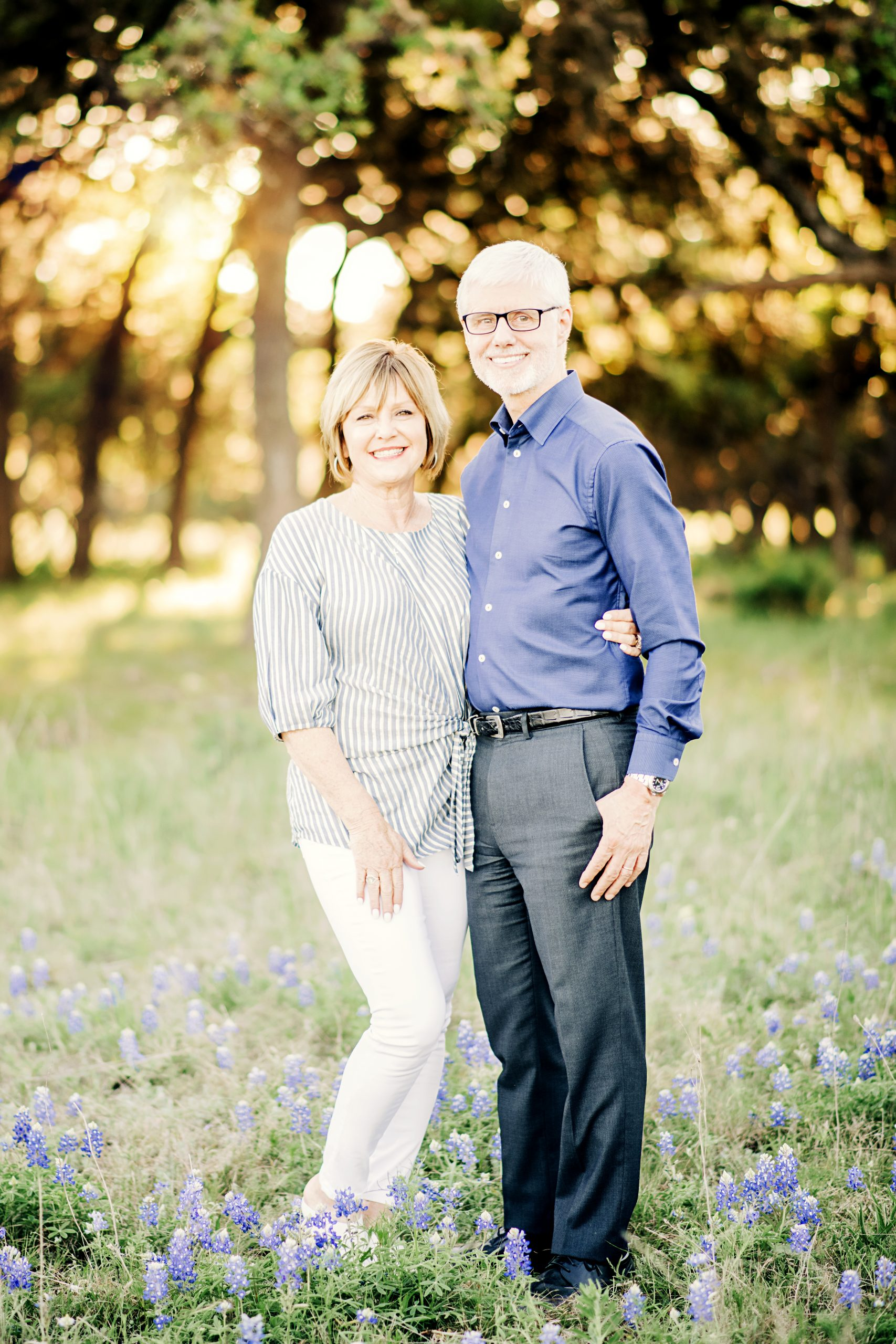 middle aged couple in bluebonnet field in texas hill country