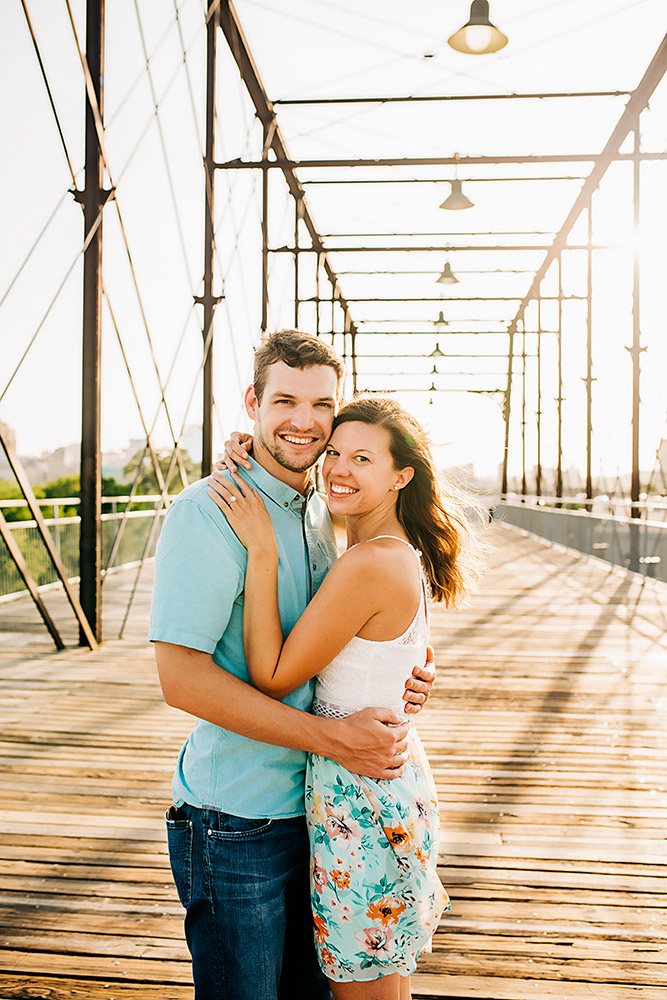 couple smiling on bridge in san antonio texas