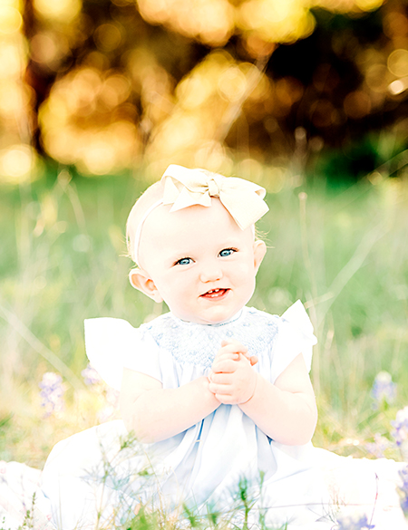 baby in bluebonnet field in texas hill country